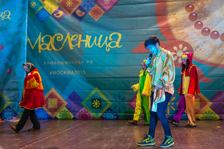 pancake week: Winter 2015. Day. Russia. Moscow. Maslenitsa (pancake week). The Celebration of Maslenitsa (pancake week). The concert in honor of the Holiday. The performance of the Skomorokhs and musicians-entertainers on the scene.