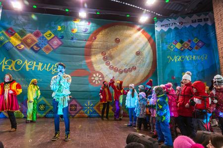 maslenitsa: Winter 2015. Day. Russia. Moscow. Maslenitsa (pancake week). The Celebration of Maslenitsa (pancake week). The concert in honor of the Holiday. The performance of the Skomorokhs and musicians-entertainers on the scene.