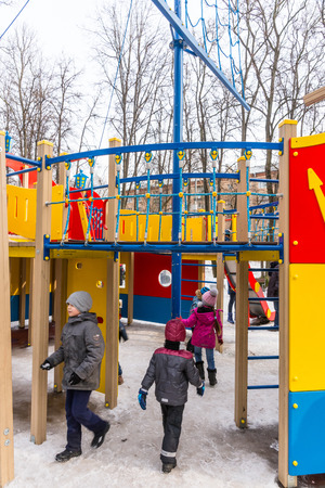 pancake week: Winter 2015. Day. Russia. Moscow. Maslenitsa (pancake week). The Celebration of Maslenitsa (pancake week). The playground for children in the Park. It is made in the form of a sailing ship. Children play on the Playground.