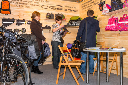 Winter 2015. Russia. Moscow. The exhibition Bikepark-2015. General view. People are walking at the exhibition. They are watching the stands with bicycles, equipment and clothes.