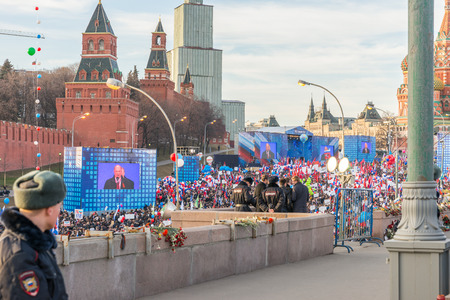demonstrator: Spring 2015. Day-evening. Russia. Moscow. The Red Squere. Vasilevsky Descent. The meeting and concert in honor of the anniversary of the reunification of the Crimea and Russia.