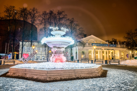 hermitage: Winter 2014. Evening. Russia. Moscow. The fountain with lights near the Hermitage Theatre. Editorial
