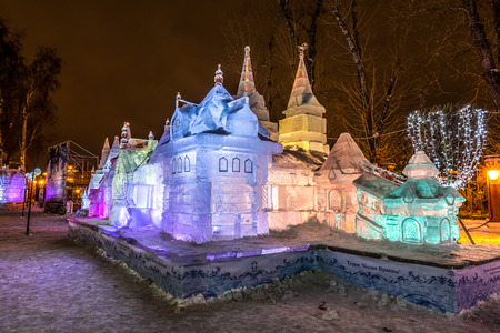 ice sculpture: Winter 2014. December. Evening. Russia. Moscow. Center. Hermitage Garden. Russian educational Park: In the Cirlce of Family.  Ice sculpture: Terem. Fary tales of Pushkin. Editorial