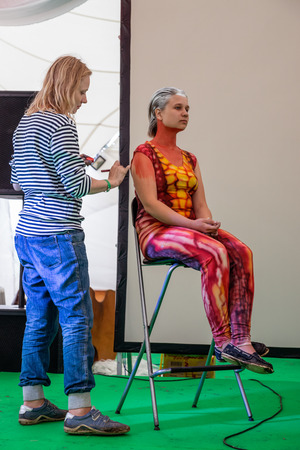wild mint: RUSSIA. TULA REGION. BUNIREVO - June 27, 2015. Musical festival Wild Mint. Demonstration of the diploma works of the students of fashion designer Irina Lukyanova during the masterclass.
