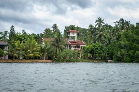 outbuilding: Sri Lanka. Bentota - August 15, 2015. The vicinity of Bentota. The house among the Jungle on the River Bank. Editorial