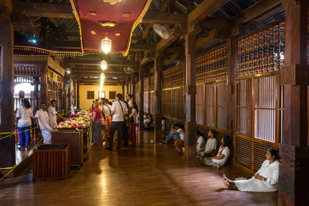 buddah: Sri Lanka. Kandy - August 16, 2015. The Tooth of Buddah Temple The Temple of the Tooth Relic. Territory Of The Temple. The inside view. People bring flowers to the Temple.