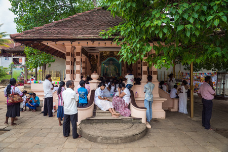 orison: Sri Lanka. Kandy - August 16, 2015. The Temple of The Tooth of Buddah. The Territory Of The Temple. People are praying. Editorial