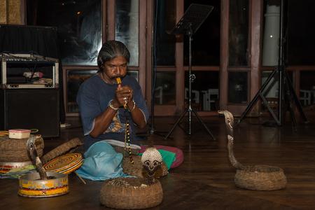 charmer: August 18, 2015 - Sri Lanka. Kalutara. Performance Of Snake Charmer. Editorial