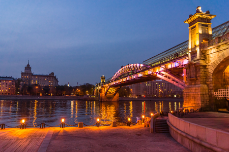 pedestrian bridges: Autumn 2013. Russia. Moscow. Central Park of Culture and Rest named after Gorky. Embankment of the Moscow river. Andreevsky Bridge. The Evening.