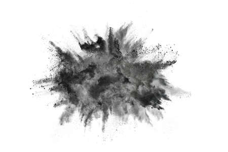 particles of charcoal on white background,abstract powder splatted on white background,Freeze motion of black powder exploding or throwing black powder. Banque d'images