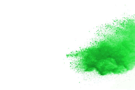 Green powder explosion on white background. Colored cloud. Colorful dust explode. Paint Holi. Archivio Fotografico