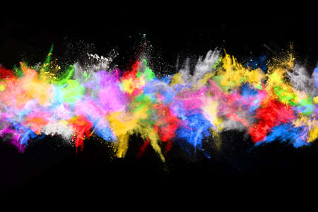abstract colored dust explosion on a black background.abstract powder splatted background,Freeze motion of color powder exploding/throwing color powder, multicolored glitter texture. Фото со стока