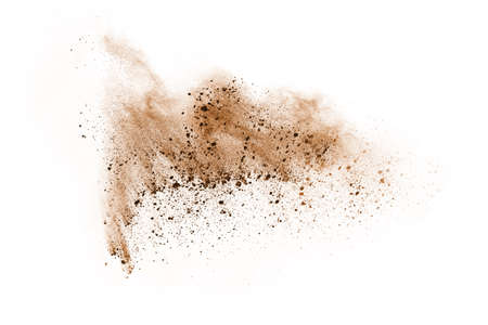 Brown color powder explosion on white background. Colored cloud. Colorful dust explode. Paint Holi. Archivio Fotografico