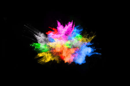 abstract colored dust explosion on a black background.abstract powder splatted background,Freeze motion of color powder exploding/throwing color powder, multicolored glitter texture. Imagens