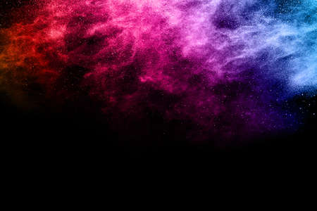 abstract colored dust explosion on a black background.abstract powder splatted background,Freeze motion of color powder exploding/throwing color powder, multicolored glitter texture. Banque d'images
