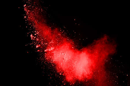 abstract red powder explosion on black background.abstract red powder splatted on black background. Freeze motion of red powder exploding. Standard-Bild