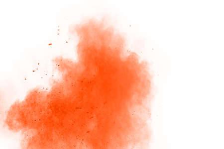 Orange powder explosion on white background. Paint Holi. Фото со стока