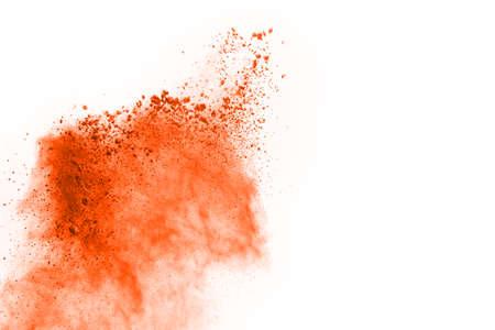 Orange powder explosion on white background. Paint Holi.