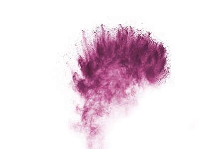 Powder explosion. Closeup of a purple dust particle explosion isolated on white. Abstract background. Фото со стока