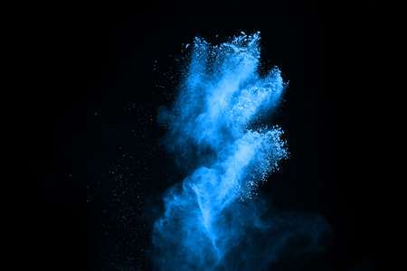 abstract blue powder splatted background,Freeze motion of color powder exploding/throwing color powder,color glitter texture on black background.