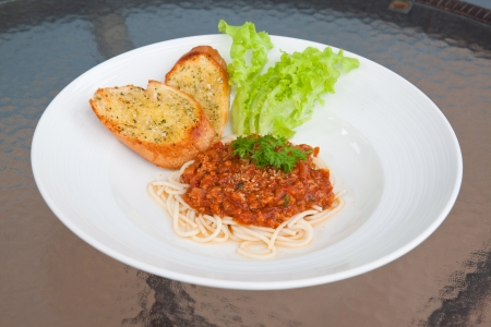 incubate: Spaghetti with tomato sauce and pork on the table  Stock Photo