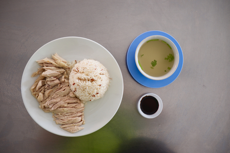 soysauce: Hainanese chicken rice with broth and black soysauce