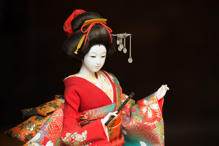 A geisha model made by silk. It is a silk crafts with traditional technology.