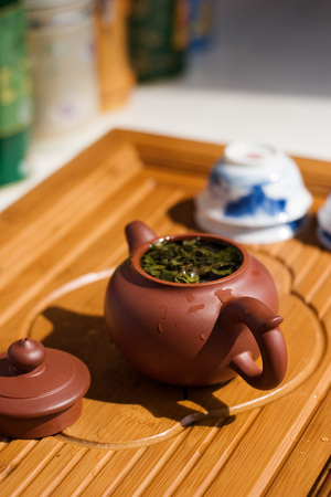 Oolong tea Brewed in a purple clay teapot. Stock Photo