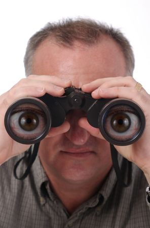exaggerate: man looking through binoculars with magnified cartoon eyes in the lenses; isolated on white; see two other versions, one normal, one with less effect