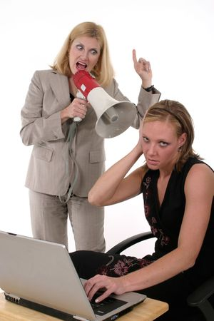 Extreme two person business team with one worker shouting commands through a megaphone