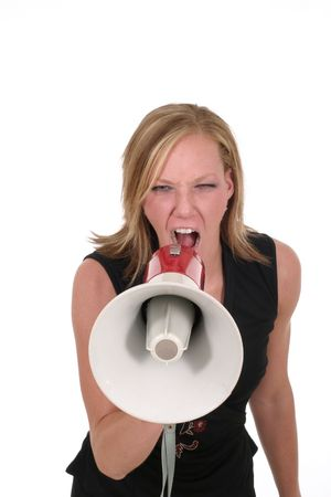 Attractive young executive business woman making her point really clear with the aid of a megaphone. Stock Photo - 430622