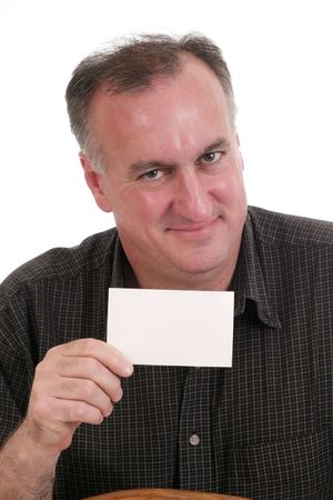 smiling man with head tilted holding blank white card suitable for text; isolated on white
