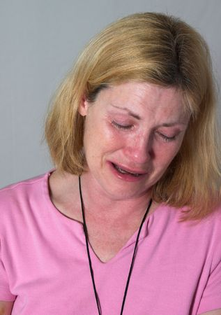 torment: very upset, grieving woman crying real tears Stock Photo