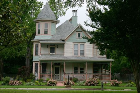 victorian house: Extremely ornate and colorful restored Victorian era house in rural city