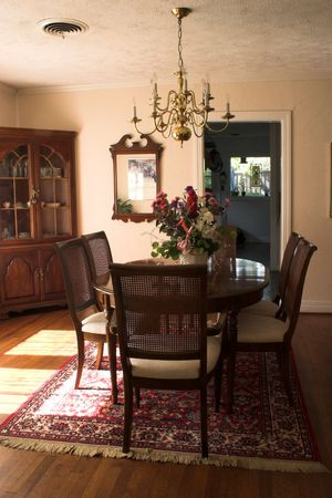 dining room table and chairs with bright sunlight streaming in through large window Stock Photo