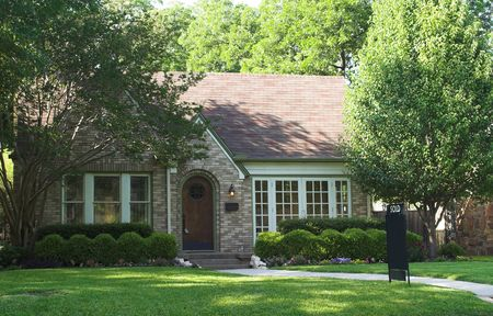 house with sold sign in yard; space on sign is blank for the addition of text Stock Photo - 441529
