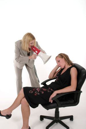 Extreme two person business team with one worker shouting commands through a megaphone photo