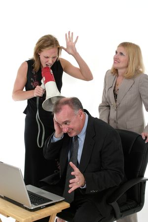 bordering: Extreme business team bordering on abuse with one worker shouting commands through a megaphone Stock Photo