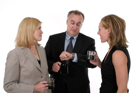 Three person business team takes a coffee break photo