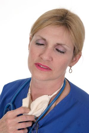 headshot photo of a beautiful, exhausted, tired, and hot nurse or doctor with stethoscope and surgical mask