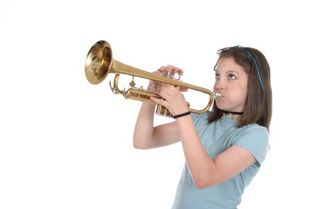 Young pre teen girl playing a trumpet. Stok Fotoğraf