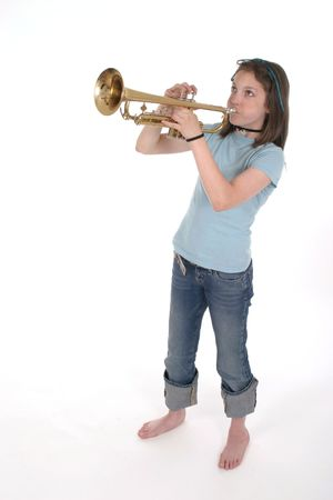 Young pre teen girl playing a trumpet. Stock Photo