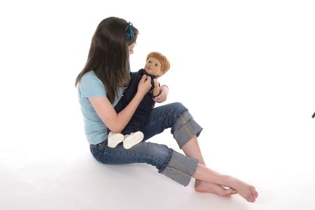 Young girl playing with a doll.