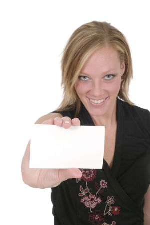 Attractive smiling business woman holding blank card with room for text.  Focus on card. photo