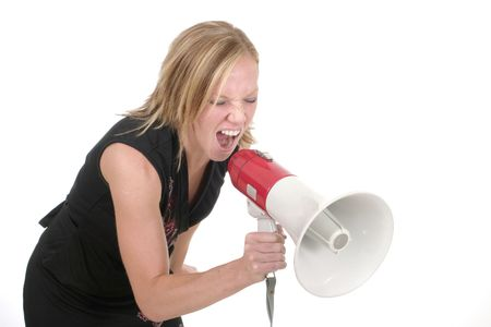 reproach: Attractive young executive business woman making her point really clear with the aid of a megaphone.