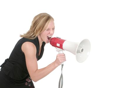 reprimand: Attractive young executive business woman making her point really clear with the aid of a megaphone.