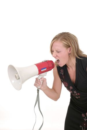 Attractive young executive business woman making her point really clear with the aid of a megaphone. Stock Photo - 454936