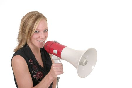 reproach: Attractive and smiling young executive business woman making her point really clear with the aid of a megaphone.