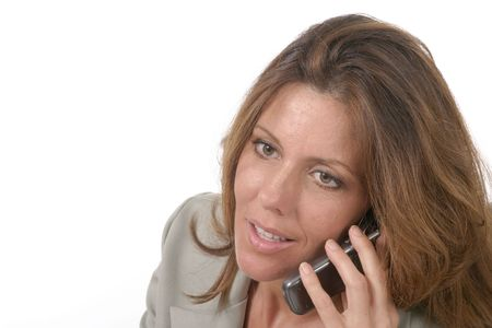 Closeup of attractive and beautiful executive business woman talking on cellphone. photo