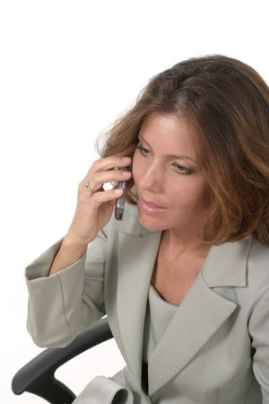 attractive and beautiful executive business woman talking on cellphone photo